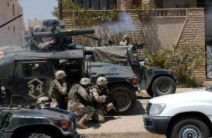 Soldiers of the Army's 101st Airborne Division (Air Assault) fire a TOW missile at a building suspected of harboring Saddam Hussein's sons Qusay and Uday in Mosul, Iraq, on July 22, 2003.