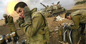 sraeli soldiers cover their ears as an artillery unit fires shells towards southern Lebanon. Image: AP